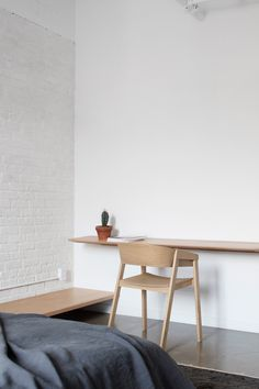 Atelier Barda renovates Montreal apartment with minimalist finishes and custom furniture