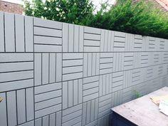 IKEA RUNNEN floor decking tiles work great as a wall fence