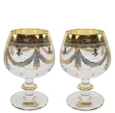 """This Italian Made Glassware is made of high quality crystal with use of the """"true engraving"""" technology. Hand-modeled glasses are solely hand-decorated with brushes to create a truly unique design, making them highly noticeable in front of mass produced machine-made competition. Engraved with bright gold and quality-controlled at every phase, this set will be an absolutely beautiful addition to your premium drink-ware collection. Comes in gift packaging and makes an impressive gift that will… Mason Jar Wine Glass, Gift Packaging, Vintage Designs, Brushes, Competition, Plating, Bright, Technology, Drink"""