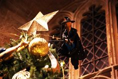 The Christmas trees were designed by the Art Department, created by the Props Department and then dressed by the Set Dressers. Finally, the Special Effects Department rigged flying witches to the top of each tree