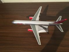 A jet2.com Boeing 757-200 from uk airline jet2 A Plastic model 1,200 scale from Premier Portfolio International Ltd,The entry level in the plastic made aeroplane kits cheapest,No reg,Plane measurements length 24cm - Width wing tip to wing tip 19cm,