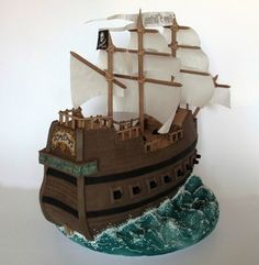 Image from side of a cake resembling a pirate ship