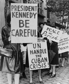 "About 800 women from Women Strike for Peace protesting on 47 Street near the UN Building during the Cuban Missile Crisis in 1962. The group advocated for nuclear disarmament and promoting peace. Their efforts led to the Partial Test Ban Treaty in 1963 ""which ended atmospheric nuclear tests."""