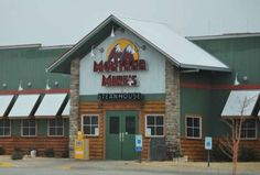 Montana Mikes. Ate dinner here Saturday night (4/13/13).  Great burgers!!  We found coupon on our map  for free 1/2 order of onion rings - so good.