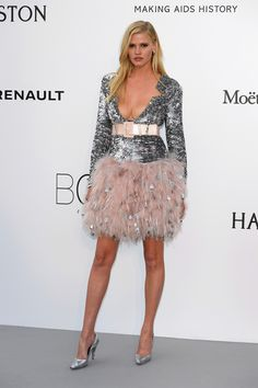 Lara Stone looks stunning in this sequin and feather Chanel dress at the Amfar Gala this year. Check out all of my favorite looks!