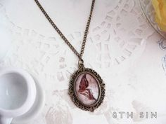 Antique Bronze Fairy Wing Cameo Necklace by 8th Sin #nymph #faerie #sprite #woodnymph #woodsprite #fairyjewelry #morigirl #dollykei #cultpartykei #cpk #classiclolita #countrylolita #lolitafashion