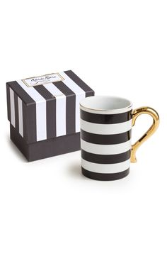 A golden handle and rim elevate the look of this black-and-white striped coffee mug that is totally chic.