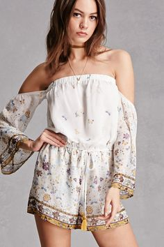 In a lightweight chiffon woven, this romper features a floral print, an elasticized off-the-shoulder neckline, long bell sleeves, a drawstring waist, and ornate trim. This is an independent brand and not a Forever 21 branded item. This item runs small, please size up.
