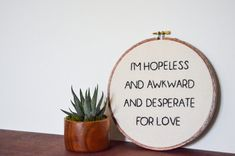 this is a custom made 8 embroidered hoop with a personal design created by randi. this canvas hoop says Im hopeless and awkward and desperate for love which is a quote from Chandler Bing from the tv series f.r.i.e.n.d.s!      a b o u t t h e p r o d u c t     - 8 wooden hoop - friends tv show quote - Chandler Bing - hand-stitched - canvas fabric - black thread      p e r f e c t f o r     - home decor - gift      c u s t o m i z e     - custom orders always available!      s h o w s o m e l…