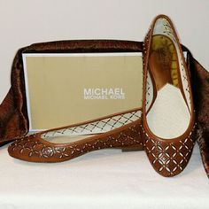 Michael Kors Gabriella Ballet Flat Luggage color leather upper with rubber traction sole.  Round toe with all-over laser-cut and logo design with gold-tone details. Sweet little casual slip-on flat by style icon Michael Kors! Michael Kors Shoes Flats & Loafers