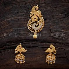 Designer swarnika pendant studded wtih synthetic ruby green stones and plated with gold polish and made of copper alloy  #pendantset #earrings #jewellery #kushalsfashionjewellery #antique