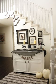 Halloween-inspired photo display - a fun way to make Halloween last longer.
