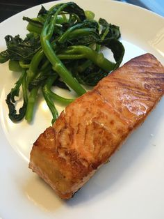 Keep it simple on hot summer days... Scottish Salmon from Faroe Island and brocoli rabe... Order salmon here and enjoy free overnight delivery - http://www.floridaseafood.com/scottish-salmon-starting-with-3-5-lbs/