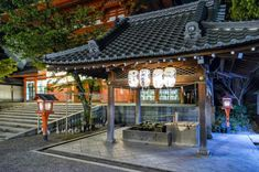 Yasaka Shrine Main Gate's Purification Fountain in Kyoto, Japan (linked article tells of Shinto beliefs, early gods, and purification ritual)