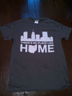 Support where you live and take our beautiful skyline everywhere you go! Make your friends jealous, because obviously your new shirt will be way cooler! This is charcoal colored shirt with a light grey design.