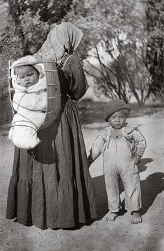 Pomo, Lakeport, California ~Repinned Via Elray Allen http://www.photographium.com/pomo-woman-carrying-baby-in-cradleboard-lakeport-california-1900-1940