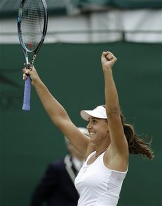 Tamira Paszek of Austria reacts after defeating Roberta Vinci of Italy during a fourth round singles match at the All England Lawn Tennis Championships at Wimbledon, England, Monday, July 2, 2012. (AP Photo/Alastair Grant)