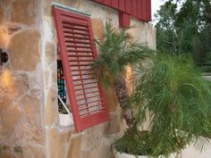 Operable louvered Exterior Shutters used to enclose a pool cabana