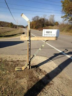 Hockey Stick Mailbox - would love this someday, but would love a hockey husband more...