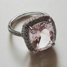 My Engagement Ring!!! Cushion Cut 4 Carat Light Pink Morganite surrounded by White Diamonds and set in Platinium... Morganite, also known as Pink Emerald or Beryl, is Todd's birthstone (October) and my favourite colour.