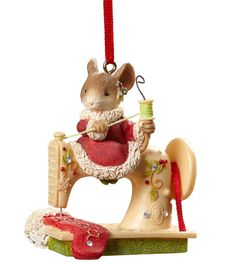 This charming mouse girl is busy sewing a red Christmas stocking. She loves to craft homemade presents on her sewing machine to give to family and friends. She spreads lots of Christmas cheer all thro