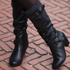 Boot features a full zip with elastic gore. Contrasting suedette panel on outer calf. A subtle velvet touch brings a fashion statement to this beautifully crafted boot. The shaft is embellished with two buckled straps.  Rialto Shoes Coralynn Black Boot Rialto