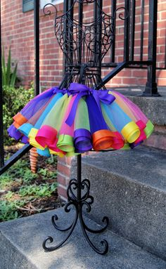 Candy Land Rainbow Satin Ribbon Trim Tutu. $45.00, via Etsy.....imagine in blues and greens with an ivory sparkly top.