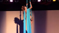 I could never perform in this little clothing (silk burns!), but the choreography is fantastic and climbs are beautiful! Midnight Martini on Aerial Silks.