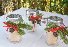Candle lanterns made from Parmesan cheese shakers from the dollar tree.