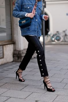 More on www.offwhiteswan.com Retro Denim Jacket by EDITED, Zara Bag with Flower Strap, Fendi Strap, Leather Pants by Mango, Lace Up Heels by NA-KD, Ray Ban Shades, Layering, Spring Streetstyle, Fashion, Trend 2017, Denim Look, Jeansjacke #swantjesoemmer #offwhiteswan