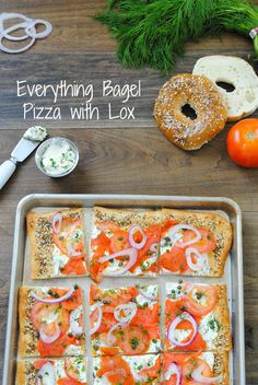 Everything Bagel Pizza with Lox - Pizza crust with homemade everything bagel seasoning, herbed cream cheese, smoked salmon, tomatoes, red onion and capers. Can be cut into small pieces for an elegant party bite! | foxeslovelemons.com