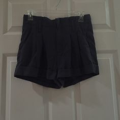 Pleated gray shorts 100% rayon. Very soft gray shorts with pleats. Zipper front Urban Outfitters Shorts