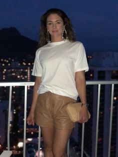 Jac & Jack white tee, Racil earrings, Viktoria & Wood leather shorts in Waikiki, Hawaii. For more style inspo, check out www.leatherandsoie.com