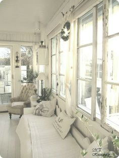 Beautiful Sun Room in creamy whites - love the tufted chair