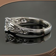 Celtic treble clef inspired ring with princess cut diamond. Follow the image link to see more views of this beauty!