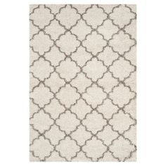The Old World style of Moroccoan tile designs comes to home décor in the classic contemporary look of the Malia Rug by Safavieh. Set in thick shag pile, these large mosiac motifs add a traditional touch to a mod, clean-line home furnishings. The soft lush pile, power-loomed from synthetic yarns, is soft underfoot, durable and easy-care for lasting beauty.