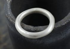 Michele Wyckoff Smith - UK: A heavy cast organic shaped wedding ring available in silver or gold.