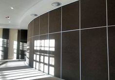 The large curved Variflex® acoustic partitions is almost 23 meters in length and the other 2 straight partition walls, are just under 15meters long. All have a height of 4.2meters. The specified finish was a Belgotex Colour Rib Carpet. Project: North West Province Legislature - Mafikeng