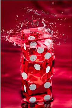 #Wet #red #dice. Awesome stop action photography.