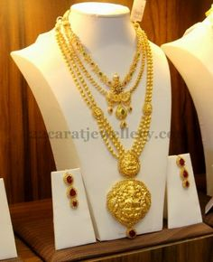 Jewellery Designs: Gold Balls Haram with Ruby Hangings