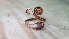 Copper wire wrapped ring with rough nugget ruby