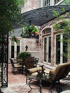 Oh, my......  Going to do this for my next client.  Wrought Iron Gazebo over Back Porch by Potter Art Metal Studios