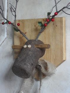 This is adorable. Reindeer plaque made from a piece of log, wooden dowels and twigs