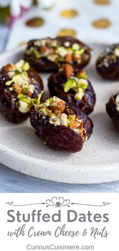 Jazz up regular dates with this simple recipe for cream cheese stuffed dates. They take minutes to make, and are a delicious snack, appetizer or dessert. Dates are an integral part of Ramadan and are eaten by Muslims throughout the year during this holy month. Finger Food Appetizers, Appetizer Recipes, Snack Recipes, Yummy Snacks, Delicious Desserts, Yummy Food, Healthy Sweets, Healthy Eating, Stuffed Dates