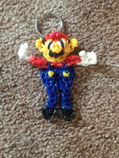 This is a Mario keychain/zipper pull that I made with Rainbow Loom bands.  It is available for purchase on my Etsy store.  They make cool party favors too!  I will custom make an order for you.
