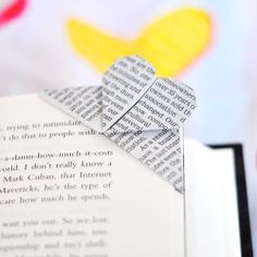 instructions on how to fold this corner heart bookmark