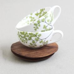 Fern Tea Cup & Saucer (Set of 2)  - THESE WONT BE IN FOR LONG!! Gorgeous range of nature-inspired handcrafted, dainty teacups and saucers. Fern design. Sustainable, contemporary high quality products. Sustainable wood sourced from alien clearing. Our hand-made designs include: 2 x 160ml porcelain tea cup and 2 x 11cm wooden saucer with a 40 mm dia. indentaiton for the cup