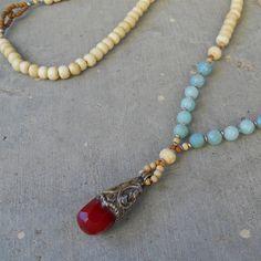 108 bone prayer necklace made with genuine bone prayer beads, and amazonite gemstones, with a beautiful hand made Tibetan pendant.