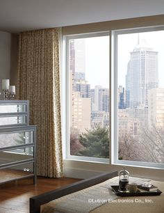 Open the curtains and soak in the view of the city in this master bedroom. Bedroom Decor Lights, Bedroom Lighting, Roller Shades, Master Bedroom, Windows, Curtains, City, Home Decor, Master Suite