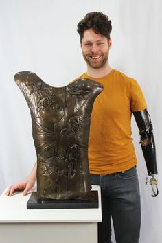 Paralympic cyclist Jon-Allan Butterworth MBE, with his bronze body cast by sculptor Louise Giblin. www.louisegiblin.co.uk